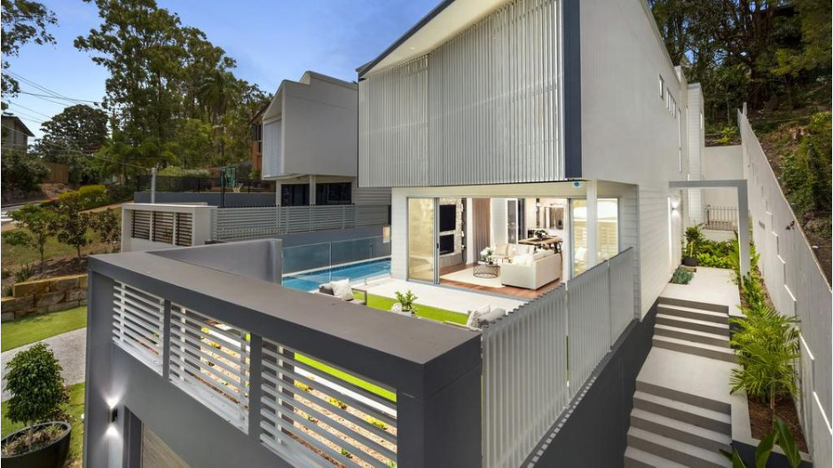 An eye-catching home with five bedrooms and four bathrooms is the perfect fit for families needing plenty of space and storage. The new three-level build at 6A Orchard Tce, St Lucia, was constructed by CS Development Group and priced at $2,590,000.